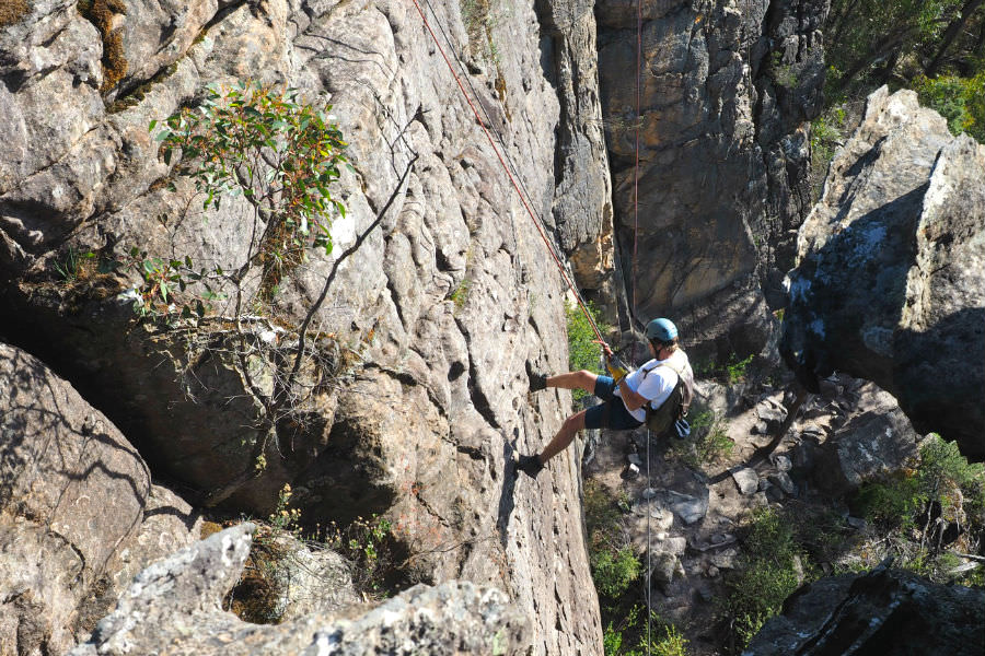 Abseiling down a rock wall Grampians